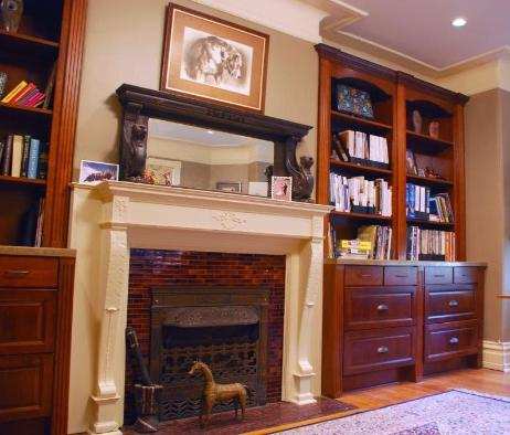 built in bookcases & fireplace mantle
