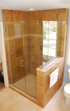 Travertine shower with frameless glass